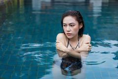 Woman is swimming in a cold plunge pool. Young woman is swimming in a cold plunge pool royalty free stock images