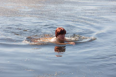 Woman swimming in cold spring water Stock Photography