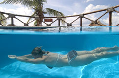 Woman swimming, Cozumel, Mexico royalty free stock images