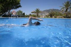 Woman swimming crawl in a pool Stock Photos