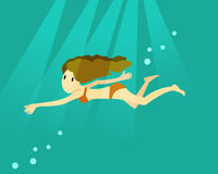 Woman swimming in the deep ocean. Royalty Free Stock Images
