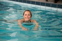 Woman swimming forward crawl in public swimming pool Stock Images