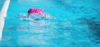 Woman swimming the front crawl Royalty Free Stock Photo