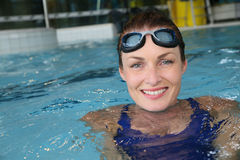 Woman with swimming goggles Stock Image