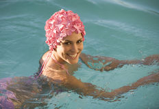 A woman in a swimming hat in a pool Royalty Free Stock Image