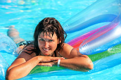 Woman swimming on inflatable beach mattress Stock Photos