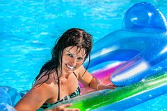 Woman swimming on inflatable beach mattress Royalty Free Stock Photo