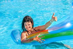 Woman swimming on inflatable beach mattress Royalty Free Stock Photos