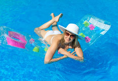 Woman swimming. Woman swimming on inflatable raft in water pool royalty free stock images