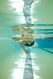 Woman swimming laps stock photo