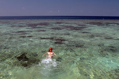 Woman swimming in the Maldives royalty free stock photo