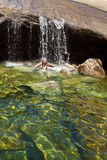 Woman swimming in a natural pool. Royalty Free Stock Photo