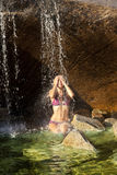 Woman swimming in a natural pool. Stock Images