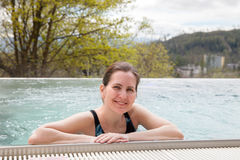 A woman is swimming in an outdoor pool in spring day Stock Photography