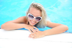 Woman in swimming pool. Portrait of beautiful young sexy blonde woman in swimming pool Stock Photos