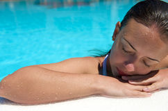 Woman at swimming pool Stock Photo