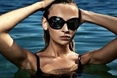 Woman at a swimming pool Stock Photo