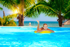 Woman in swimming pool. Funny woman with inflatable tube in swimming pool Royalty Free Stock Photo