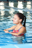 Woman swimming in pool Stock Photo