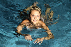 The woman in swimming pool Royalty Free Stock Image