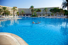 Woman in swimming pool. Blue swiming pool in hotel. Turkey Royalty Free Stock Images
