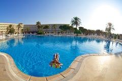 Woman in swimming pool. Blue swiming pool in hotel. Turkey Royalty Free Stock Image
