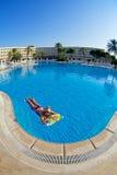 Woman in swimming pool. Blue swiming pool in hotel. Turkey Stock Photo