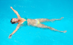 Woman in a swimming pool Royalty Free Stock Photos