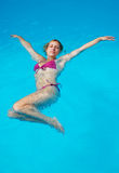 Woman in a swimming pool Stock Images
