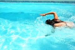 Woman in swimming pool. Woman having fun in swimming pool Royalty Free Stock Photo
