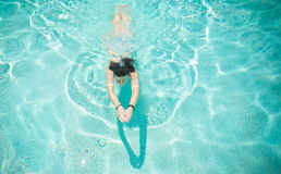 Woman Swimming in Pool. On a sunny day Royalty Free Stock Photography