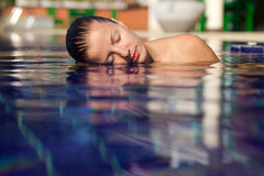 Woman in swimming pool Stock Image