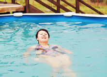Woman is swimming in a pool Stock Images