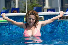 Woman in the swimming pool. Beautiful young woman relaxing in the swimming pool Royalty Free Stock Photography