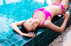 Woman in the swimming pool Stock Images
