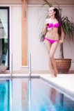 Woman by the swimming pool Royalty Free Stock Photo