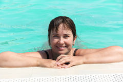 Woman in the swimming pool Stock Photos