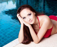 Woman by the swimming pool Royalty Free Stock Image