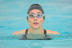 Woman swimming on pool Royalty Free Stock Images
