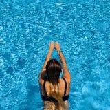Woman swimming in pool. Stock Photo