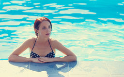 Woman at swimming pool. Stock Photography