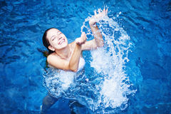 Woman swimming in a pool Stock Photo