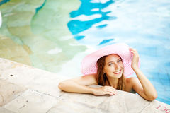 Woman swimming in a pool Stock Photography