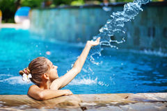 Woman swimming in a pool stock images