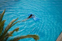 Woman in a swimming pool. Beautiful young woman relaxing in a swimming pool Royalty Free Stock Photos