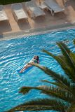 Woman in a swimming pool. Beautiful young woman relaxing in a swimming pool Stock Images