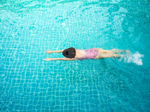 Woman swimming in pool. Royalty Free Stock Photography