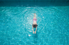 Woman swimming in pool. Royalty Free Stock Photos