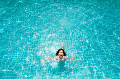 Woman swimming in pool. Royalty Free Stock Photo