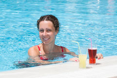 Woman swimming in the pool Royalty Free Stock Photo